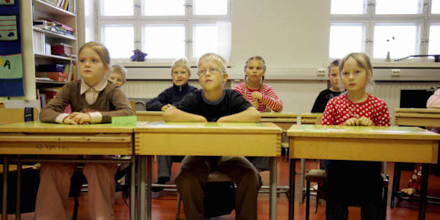 Vaasa (Vasa), FINLAND:  Children listen to their teacher 17 August 2005 in a primary school in Vaasa, on the second day of school in Finland. Because of the track and field World Championships in Helsinki, most of the schools have postponed by one week opening of their new season. According to a recent European study, Finland is the country which has best school results in Europe thanks to its teaching system. AFP PHOTO OLIVIER MORIN  (Photo credit should read OLIVIER MORIN/AFP/Getty Images)