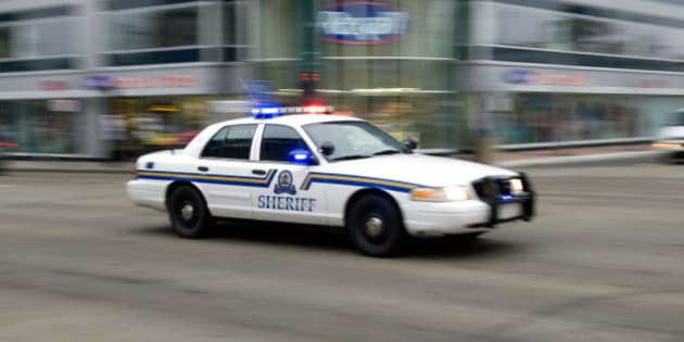 EDMONTON, CANADA - OCTOBER 21:   A sheriff's car speeds through the downtown streets on its way to a hostage situation at the Workers' Compensation Board building on October 21, 2009 in Edmonton, Alberta, Canada. The armed man who may be holding two hostages and have had up to 11 earlier in the day is a disgruntled workers' compensation claimant.  (Photo by Dylan Lynch/Getty Images)
