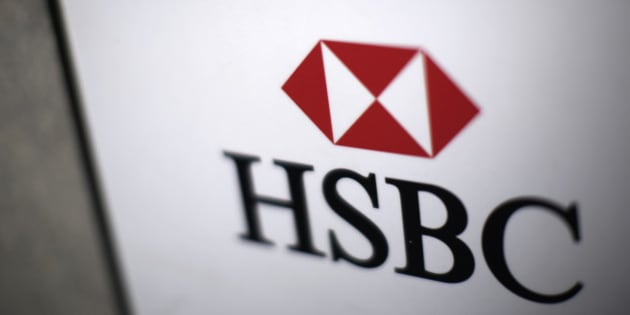 A logo sits on a sign outside a HSBC Holdings Plc bank branch in London, U.K., on Monday, Dec. 9, 2013. HSBC may sell a stake in its U.K. retail and commercial bank on the stock exchange to ease the effect of new regulations, the Financial Times newspaper reported. Photographer: Matthew Lloyd/Bloomberg via Getty Images