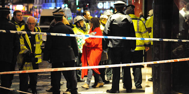 LONDON, UNITED KINGDOM - DECEMBER 19: Members of the emergency services work at the scene after the roof collapsed at The Apollo Theatre on December 19, 2013 in London, England. A number of people have been seriously injured after part of the roof of the famous West End theatre collapsed during a packed performance of 'The Curious Incident of the Dog in the Night-Time'. (Photo by Alan Chapman/Getty Images)