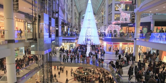 TORONTO - NOVEMBER 23: Christmas shopping at the Eaton Centre on November 23, 2012 in Toronto. The mall contains a wide selection of 230 stores and restaurants.