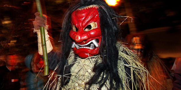 OGA, JAPAN - FEBRUARY 13:  A man dressed in straw clothes and an orge mask as Namahage, or a mountain demon, marches through the grounds of the shrine during the Namahage Sedo Festival at Shinzan Shrine on February 13, 2010 in Oga, Akita, Japan. Namahage visit each house to admonish sluggards to mend their ways, ward off disasters and offer blessings, looking for evil children, in the region on New Year's Eve. In the festival, which combines the local event of the ceremony of the shrine, visitors can experience these traditions and its folk culture.  (Photo by Kiyoshi Ota/Getty Images)