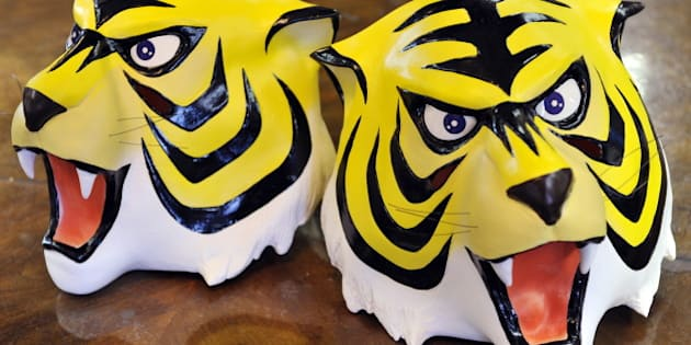 Rubber masks of cartoon character 'Tiger Mask' a masked professional wrestling manga hero is displayed at Japanese toy mask maker Ogawa Rubber's headquaters in Saitama city, suburban Tokyo on January 13, 2011. Japan has been enthralled by the mysterious comeback of a 1960s manga comic book hero that has sparked a nationwide wave of gift-giving by anonymous donors to underprivileged children. The spate of donations started on Christmas Day, when presents were left at a children's welfare centre near Tokyo, with a note saying they came from 'Naoto Date', the alter ego of professional wrestling character 'Tiger Mask'. The widely reported gift struck a chord with Japanese who fondly remember Tiger Mask -- an orphan-turned-fighter who helped other parentless children -- and has sparked more than 30 copycat acts of generosity since, Kyodo News said.  AFP PHOTO / Yoshikazu TSUNO (Photo credit should read YOSHIKAZU TSUNO/AFP/Getty Images)
