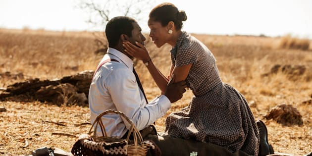 UNSPECIFIED LOCATION,  UNSPECIFIED DATE: In this handout photo provided by The Weinstein Compan, Idris Elba (L) and Naomie Harris are seen on the set of 'Mandela: Long Walk to Freedom'.   (Photo by Keith Bernstein/The Weinstein Company via Getty Images)