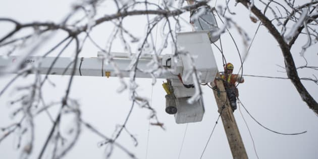 SCARBOROUGH, ON - DECEMBER 25 - Ben Brown from Sault Ste. Marie flew to Toronto to help restore power on Christmas Day to households in Scarborough that have been without electricity since a major ice storm struck Toronto. December 25, 2013.        (Randy Risling/Toronto Star via Getty Images)