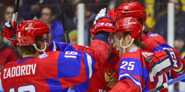 Russia's Mikhail Grigorenko, right no.25, celebrates scoring against Canada during the World Junior Hockey Championships bronze match at Malmo Arena in Malmo, Sweden on Sunday, Jan. 5, 2014. (AP Photo/TT News Agency, Ludvig Thunman) SWEDEN OUT