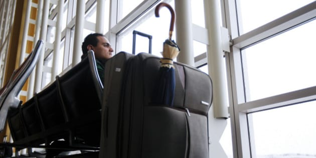 Traveler Younsi Yassine waits for another flight to New York after a cancellation at Reagan National Airport in Washington, D.C., U.S., on Wednesday, March 6, 2013. Light snow mixed with rain fell in Washington, where federal offices were closed and more than 1,000 flights scratched, as the city braced for a winter storm that dumped more than 9 inches on Chicago. Photographer: Andrew Harrer/Bloomberg via Getty Images