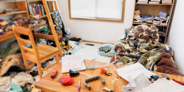 Teenage boy's messy room. Tilt shift lens, with focus on pillow & comforter
