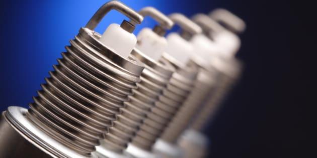 spark plug on blue background