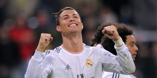 MADRID, SPAIN - JANUARY 06:  Cristiano Ronaldo of Real Madrid CF celebrates after scoring their third goal during the La Liga match between Real Madrid CF and RC Celta de Vigo at the Santiago Bernabeu stadium on January 6, 2014 in Madrid, Spain.  (Photo by Denis Doyle/Getty Images)