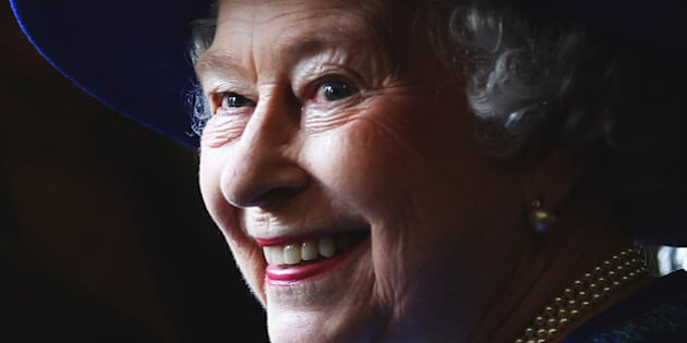 File photo dated 04/07/13 of Queen Elizabeth II, smiling as she watches Soldiers from the Royal Regiment of Scotland 3 Scots, march past after she presented the regiment with a Pipe Banner, at Dreghorn Barracks in Edinburgh.