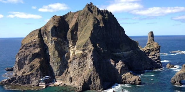 DOKDO/TAKESHIMA ISLANDS, SOUTH KOREA - OCTOBER 4: A fisherman and his wife live at the base of the taller of Dokdo's main two islands, in South Korea on October 4, 2012. (Photo by Chico Harlan/The Washington Post via Getty Images)