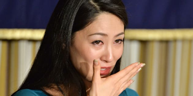 Miss International 2012, Ikumi Yoshimatsu of Japan, reacts as she speaks during a press conference at the Foreign Correspondents' Club of Japan in Tokyo on December 16, 2013. A Japanese beauty queen who became the first Japanese in half a century to win the Miss International title, spoke to press about the campaign of harrassment she claims to have suffered.    AFP PHOTO / KAZUHIRO NOGI        (Photo credit should read KAZUHIRO NOGI/AFP/Getty Images)