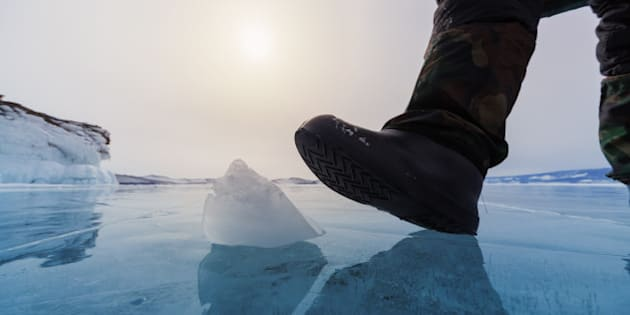 Frozen Lake Baikal and human leg