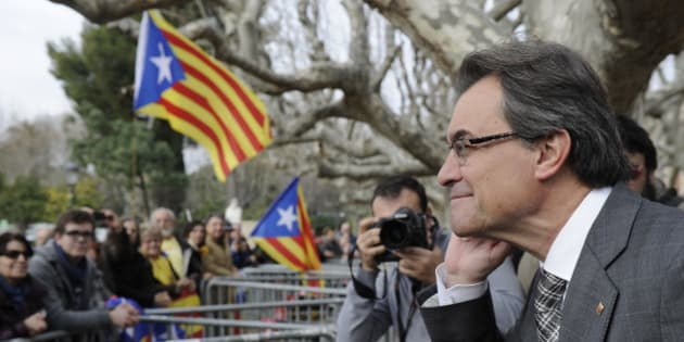 President of the Catalonian regional government Artur Mas gestures as he listens to independentist people outside Catalonia's parliament after a vote for a petition to the national parliament in Barcelona on January 16, 2014. The Catalan Parliament voted 87 to 43 with 3 abstentions, demanding Madrid the authorization to organise an independance referendum.   AFP PHOTO/ JOSEP LAGO        (Photo credit should read JOSEP LAGO/AFP/Getty Images)