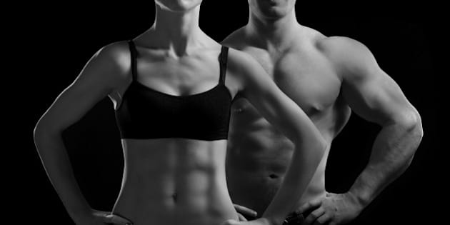 981112d759 Bodybuilding. Strong man and a woman posing on a black background