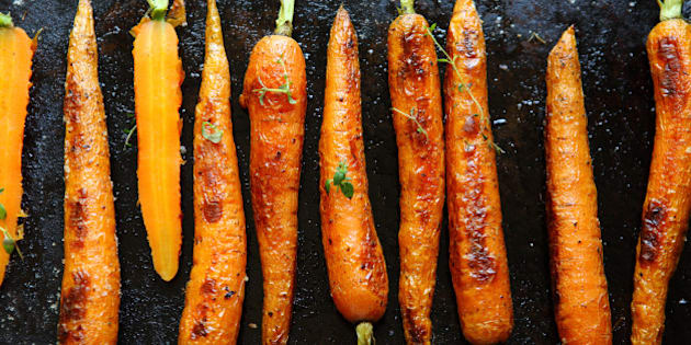 baked carrots on a baking sheet ...