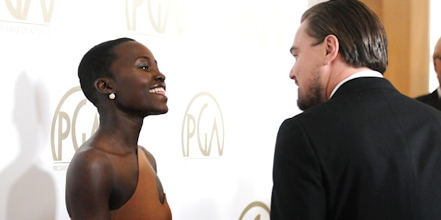BEVERLY HILLS, CA - JANUARY 19:  Actress Lupita Nyong'o and actor Leonardo DiCaprio attend the 25th annual Producers Guild Awards at The Beverly Hilton Hotel on January 19, 2014 in Beverly Hills, California.  (Photo by Jason LaVeris/FilmMagic)