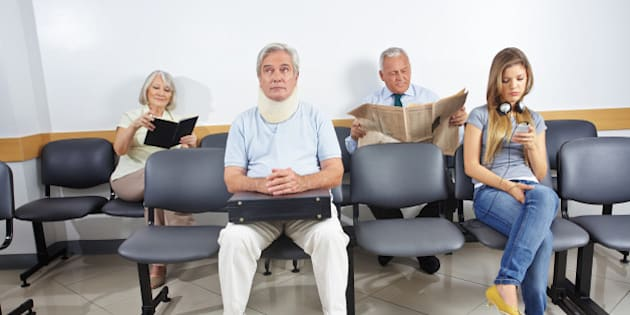 Different people sitting in a waiting room of a hospital
