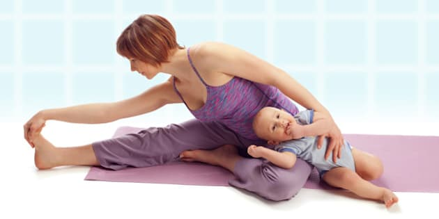 Yoga for woman and child / Mother with her baby boy doing yoga exercise