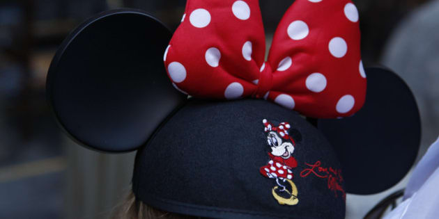 A guest wearing Minnie Mouse ears waits for the Splash Mountain ride at Walt Disney Co.'s Disneyland Park, part of the Disneyland Resort, in Anaheim, California, U.S., on Wednesday, Nov. 6, 2013. The Walt Disney Co. is scheduled to release earnings figures on Nov. 7. Photographer: Patrick Fallon/Bloomberg via Getty Images