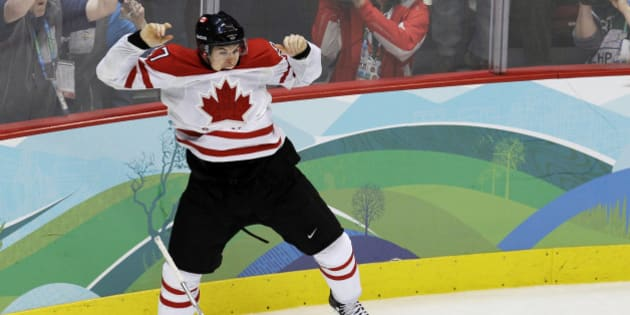 FILE - In this Feb. 28, 2010, file photo, Canada's Sidney Crosby (87) leaps in the air after making the winning goal in the overtime period of a men's gold medal ice hockey game against USA at the Vancouver 2010 Olympics in Vancouver, British Columbia. With the Olympics less than a year off and both sides talking tough, chances that NHL players won't compete in the Winter Games are only slightly better than a snowball in well, Sochi. (AP Photo/Chris O'Meara, File)