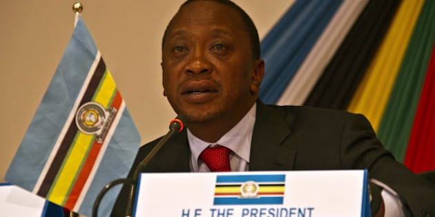 Kenyas president Uhuru Kenyatta attends the signing of the third important pillar of integration, East African Community Monetary Union on November 30, 2013 in Kampala. East African Community heads of state hold talks in Uganda aimed to boost integration and cross-border trade, even as internal rivalries threaten to weaken the five-nation bloc. AFP PHOTO/ Isaac Kasamani        (Photo credit should read ISAAC KASAMANI/AFP/Getty Images)