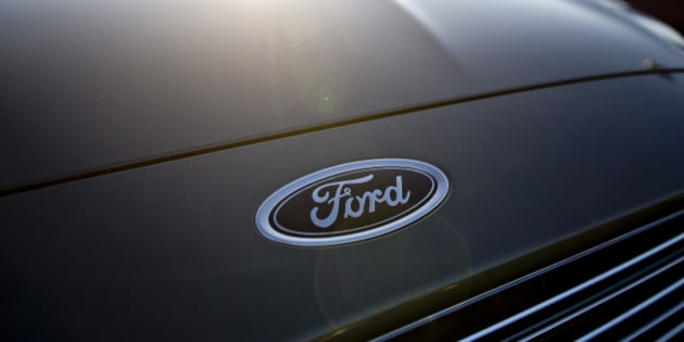 A Ford Motor Co. emblem appears above the grille of a 2014 Ford Fusion at Uftring Ford in East Peoria, Illinois, U.S., on Saturday, Nov. 30, 2013. Automakers entered their year-end sales push in November with the most cars and trucks on U.S. dealer lots in eight years, a buildup thats poised to test the industrys newfound pricing discipline. Photographer: Daniel Acker/Bloomberg via Getty Images