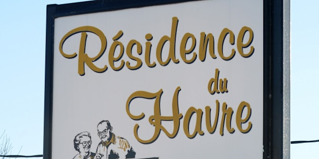 A sign points to the retirement home 'Residence du Havre,' a pharmacy and a grocery store in L'Isle-Verte, a small town 450 kilometers (280 miles) northeast of Montreal with a population of around 1,400 people, January 24, 2014. Canadian firefighters on Thursday searched the ashes of the Quebec retirement home in L'Isle-Verte that burned to the ground on a bleak midwinter night, leaving more than 30 residents feared dead. Officials said the remains of three victims had been recovered and some 30 more were unaccounted for, while the local fire chief said rescuers were now searching for bodies.  The blaze at the home, which housed around 50 to 60 elderly people in 52 units, broke out shortly after midnight.  AFP PHOTO/Remi SENECHAL        (Photo credit should read Remi Senechal/AFP/Getty Images)