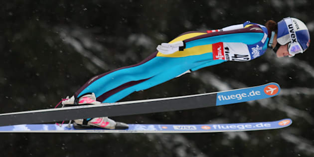 US Sarah Hendrickson soars through the air at the Women's Normal Hill  event of the FIS Nordic World Ski Championships at the Ski Jumping stadium in Predazzo, north Italy on February 22, 2013. AFP PHOTO / PIERRE TEYSSOT        (Photo credit should read Pierre Teyssot/AFP/Getty Images)