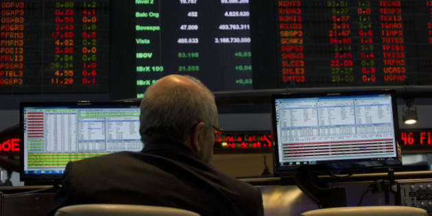A system operator at Sao Paulo's Stock Exchange (Bovespa) looks at a monitor, in Sao Paulo, Brazil, on October 2, 2013.  AFP PHOTO / Nelson ALMEIDA        (Photo credit should read NELSON ALMEIDA/AFP/Getty Images)