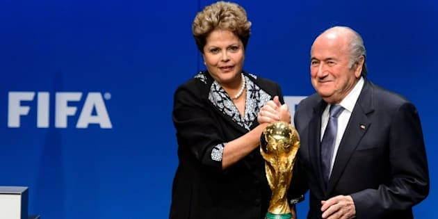 President of football's world governing body FIFA, Sepp Blatter (R) poses with Brazilian President Dilma Rousseff while shaking hands on January 23, 2013 at the FIFA heaquarters in Zurich, after their meeting for updates on the preparations for the 2014 FIFA World Cup in Brazil, taking place from June 12 to July 13. AFP PHOTO / FABRICE COFFRINI        (Photo credit should read FABRICE COFFRINI/AFP/Getty Images)