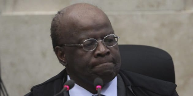 BRASILIA, BRAZIL - SEPTEMBER 12:  (BRAZIL OUT) President of the Supreme Court Joaquim Barbosa chairs a plenary session on the trial of the criminal action 470, mensalao at the the Supreme Court on September 12, 2013 in Brasilia, Brazil. (Photo by Andre Coelho/Globo via Getty Images)