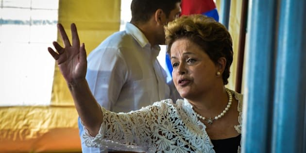 Brazilian President Dilma Rousseff waves on January 27, 2014, during the inauguration of first stage of the Mariel port and special development zone, in Mariel, Artemisa province, Cuba.     AFP PHOTO/ADALBERTO ROQUE        (Photo credit should read ADALBERTO ROQUE/AFP/Getty Images)
