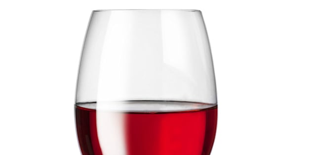 isolated glass with red wine