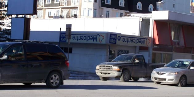 """I saw this, and wandered, what the story was, as to why the """"Medicentre"""" sign was upside down.  I assume the business is shut down.  But, I don't see why the sign would be flipped, instead of removed, or left right-side-up."""