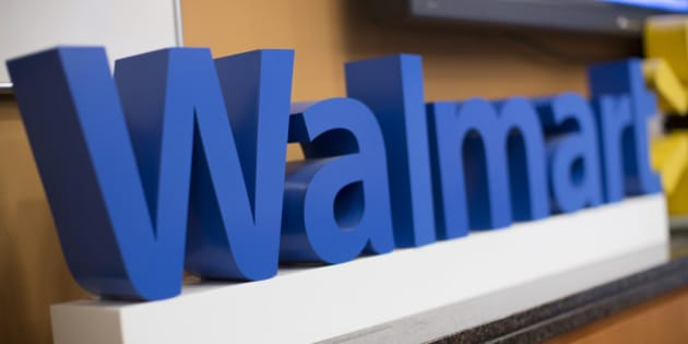 The Wal-Mart Stores Inc. logo is displayed during a media briefing with Scott Price, chief executive officer for Asia at Wal-Mart, in Hong Kong, China, on Wednesday, Dec. 18,  2013. Indias antitrust body approved Wal-Marts purchase of a stake in its former partner Bharti Enterprises Pvt., Price said in Hong Kong today. Photographer: Jerome Favre/Bloomberg via Getty Images