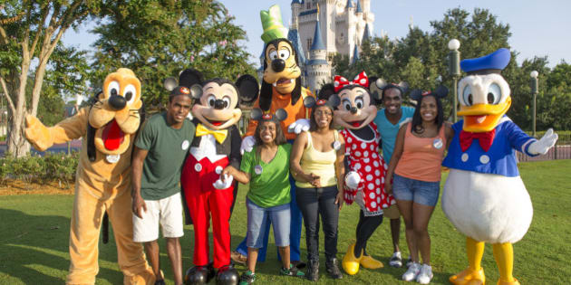 LAKE BUENA VISTA, FL - AUGUST 05:  In this handout photo provided by Disney Parks, the Gaither Quintuplets, from Indianapolis, Ind., celebrated their 30th birthdays in the Magic Kingdom at Walt Disney World August 5, 2013 in Lake Buena Vista, Florida.  (L-R): Joshua Gaither, Ashlee Gaither, Renee Gaither-Williams, Brandon Gaither and Rhealyn Gaither-Thomas.  The five siblings, the first surviving set of African-American quintuplets born in the U.S., posed with five of Disney's most famous characters, Pluto, Mickey Mouse, Goofy, Minnie Mouse and Donald Duck.  The quintuplets, born Aug. 3, 1983, last visited Walt Disney World as a family to celebrate their 10th birthdays.  (Photo by Gene Duncan/Disney Parks via Getty Images)