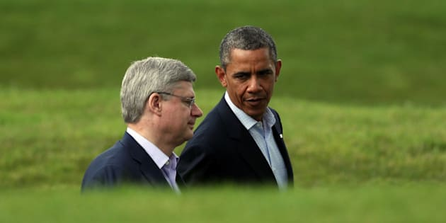 ENNISKILLEN, NORTHERN IRELAND - JUNE 18:  US President Barack Obama (R) talks with Canadian Prime Minister Stephen Harper following the 'family' group photograph at the G8 venue of Lough Erne on June 18, 2013 in Enniskillen, Northern Ireland. The two day G8 summit, hosted by UK Prime Minister David Cameron, is being held in Northern Ireland for the first time. Leaders from the G8 nations have gathered to discuss numerous topics with the situation in Syria expected to dominate the talks.  (Photo by Matt Cardy/Getty Images)