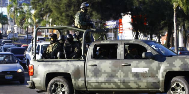Mexican soldiers patrolduring a military operation during which Ruben Oseguera Gonzalez, aka 'el Menchito' son of the leader of the Jalisco next Generation cartel, was arrested, in Guadalajara, Mexico on January 30, 2014.AFP PHOTO/Hector Guerrero        (Photo credit should read HECTOR GUERRERO/AFP/Getty Images)