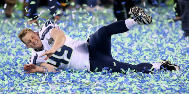 EAST RUTHERFORD, NJ - FEBRUARY 02:  Long snapper Clint Gresham #49 of the Seattle Seahawks celebrates their 43-8 victory over the Denver Broncos to win Super Bowl XLVIII at MetLife Stadium on February 2, 2014 in East Rutherford, New Jersey.  (Photo by Stephen Dunn/Getty Images)