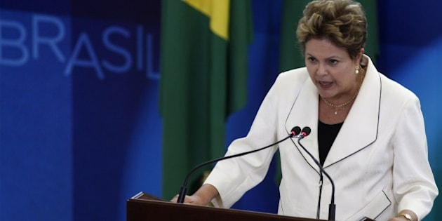 Brazilian President Dilma Rousseff delivers a speech during the inauguration ceremony of new ministers at Planalto Palace in Brasilia, on February 03, 2014. The new ministers are Aloizio Mercadante of Civilian Household, Henrique Paim of Education, Arthur Chioro of Health and Thomas Traumann as presidency spokesperson.  AFP PHOTO/Beto BARATA        (Photo credit should read BETO BARATA/AFP/Getty Images)