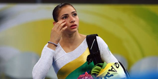 BEIJING - AUGUST 10:  Lais Souza of Brazil walks off of the floor after competing the qualification round for the women's artistic gymnastics event held at the National Indoor Stadium during Day 2 of the 2008 Summer Olympic Games on August 10, 2008 in Beijing, China.  (Photo by Vladimir Rys/Bongarts/Getty Images)