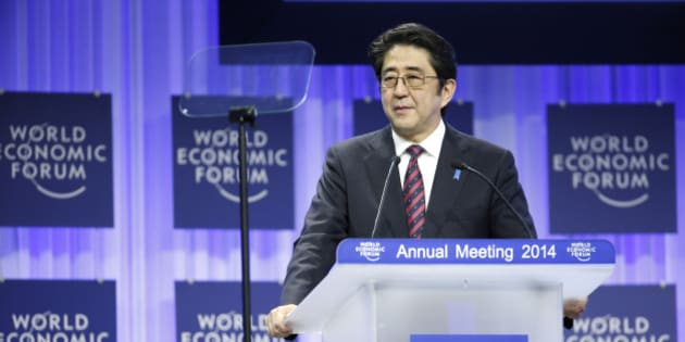 Shinzo Abe, Japan's prime minister, speaks during a session on the opening day of the World Economic Forum (WEF) in Davos, Switzerland, on Wednesday, Jan. 22, 2014. World leaders, influential executives, bankers and policy makers attend the 44th annual meeting of the World Economic Forum in Davos, the five day event runs from Jan. 22-25. Photographer: Jason Alden/Bloomberg via Getty Images