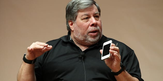 Steve Wozniak, co-founder of Apple Inc., holds an iPhone as he speaks at Hanyang University in Seoul, South Korea, on Thursday, May 31, 2012. Wozniak is chief scientist at Fusion-io Inc., a maker of flash-memory technology. Photographer: SeongJoon Cho/Bloomberg via Getty Images
