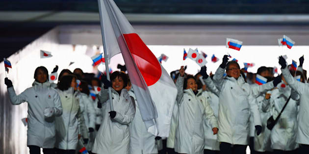 SOCHI, RUSSIA - FEBRUARY 07:  Curler Ayumi Ogasawara of the Japan Olympic team carries her country's flag during the Opening Ceremony of the Sochi 2014 Winter Olympics at Fisht Olympic Stadium on February 7, 2014 in Sochi, Russia.  (Photo by Pascal Le Segretain/Getty Images)