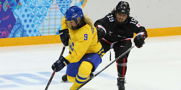 SOCHI, RUSSIA - FEBRUARY 09: Josefine Holmgren #9 of Sweden is challenged by Miho Shishiuchi #19 of Japan during the Women's Ice Hockey Preliminary Round Group B Game between Sweden and Japan on day 2 of the Sochi 2014 Winter Olympics at Shayba Arena on February 9, 2014 in Sochi, Russia.  (Photo by Robert Cianflone/Getty Images)
