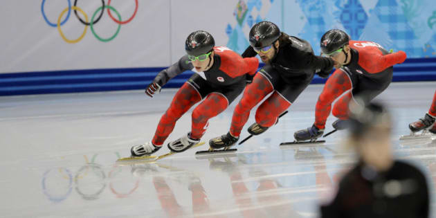 Charles Hamelin of Canada, centre, and fellow team members train during a short track speedskating practice session at the Iceberg Skating Palace ahead of the 2014 Winter Olympics, Thursday, Feb. 6, 2014, in Sochi, Russia. (AP Photo/Vadim Ghirda)