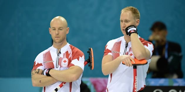 Canada's Brad Jacobs (R) talks with his teammate Ryan Fry during the 2014 Sochi winter olympics men's curling round robin session 1 match against Germany at the Ice Cube curling centre in Sochi on February 10, 2014. AFP PHOTO / JUNG YEON-JE        (Photo credit should read JUNG YEON-JE/AFP/Getty Images)