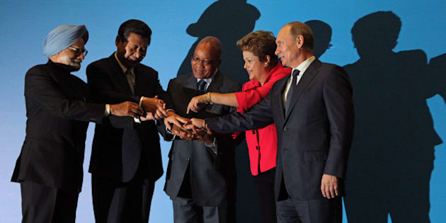 DURBAN, SOUTH AFRICA - MARCH 27:  (L-R) Indian Prime Minister Manmohan Singh, Chinese President Xi Jinping, South Africa President Jacob Zuma, Brazil's President Dilma Rousseff and Russian President Vladimir Putin pose for photographers during the BRICS Summit on March, 27,2013 in Durban, South Africa. In the fifth summit of the BRICS nations leaders, they talked about forming a development bank to aid developing nations.  (Photo by Sasha Mordovets/Getty Images)